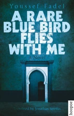 A RARE BLUE BIRD FLIES WITH ME BY. Youssef Fadel  TRANS. Jonathan Smolin